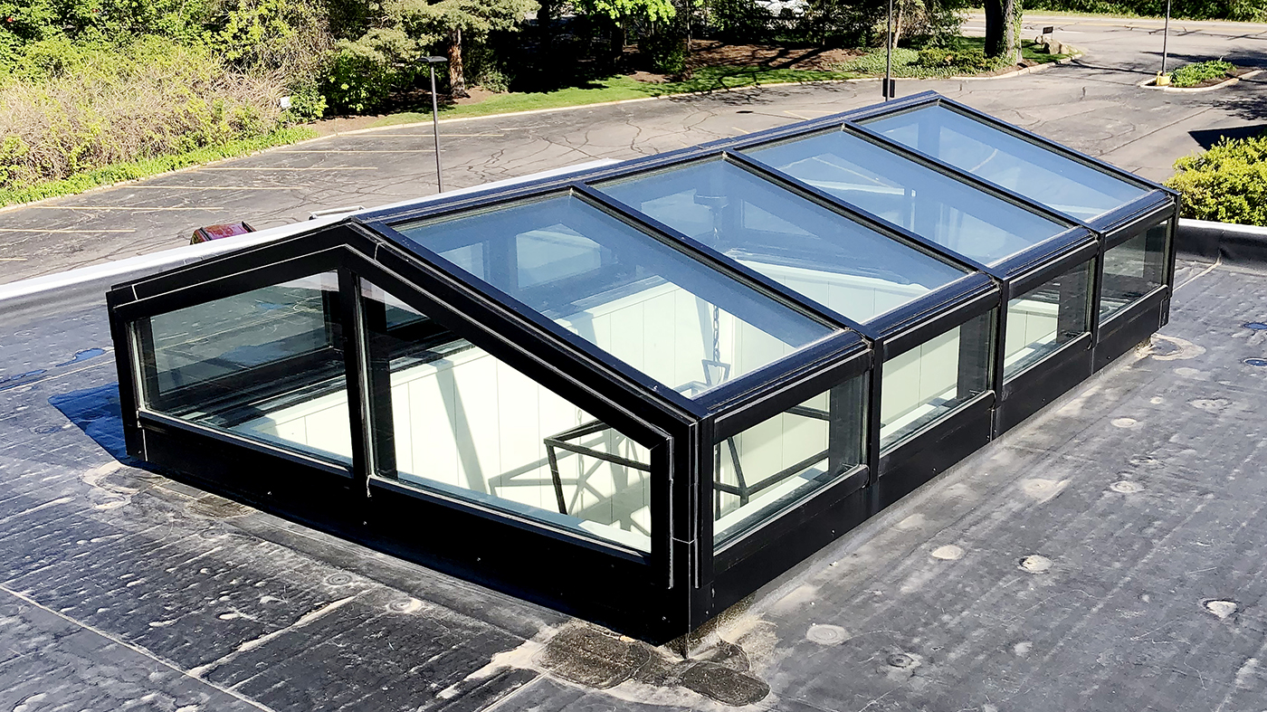 Straight eave double pitch skylight with a transom