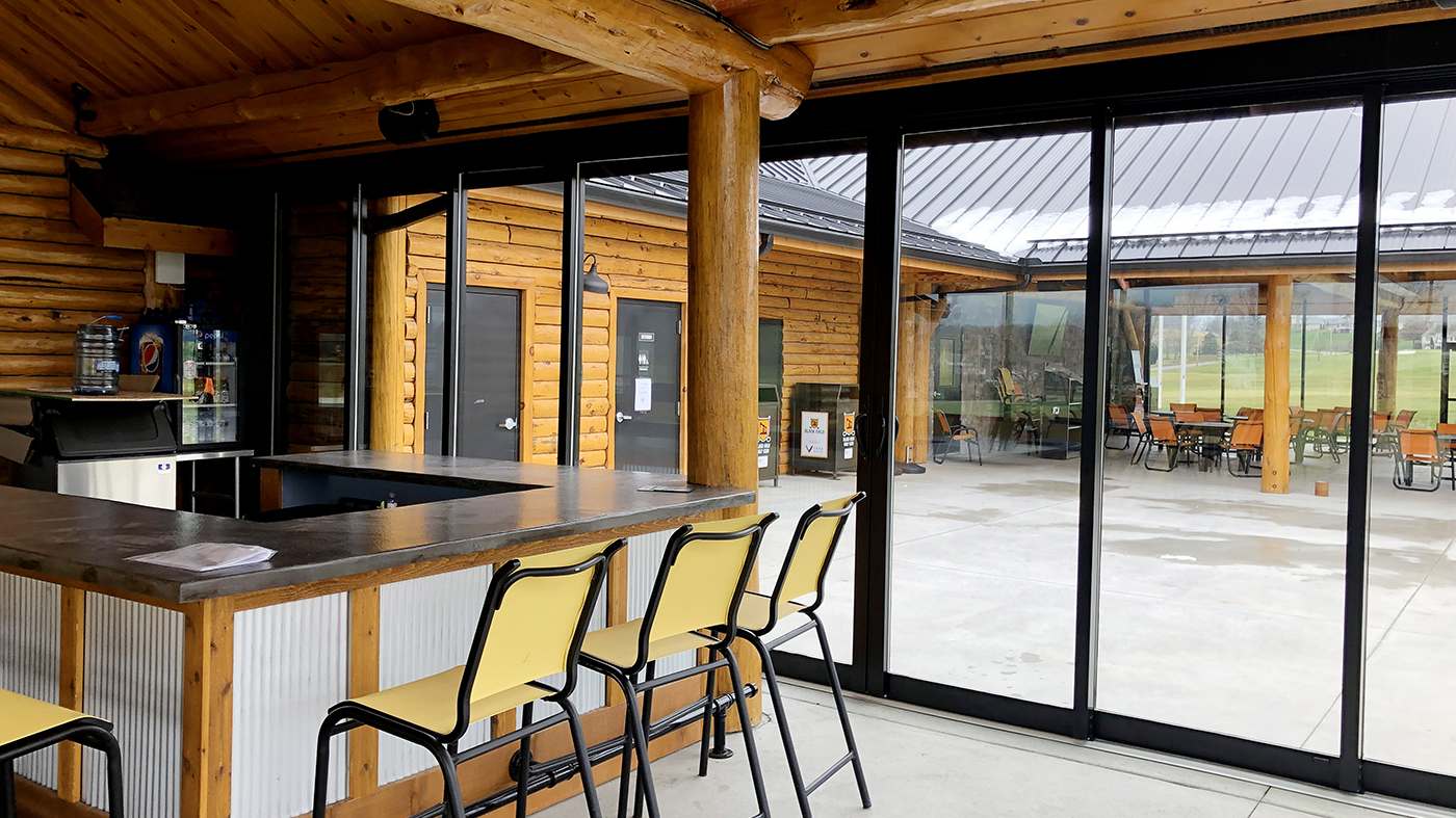 Multi-track sliding glass doors