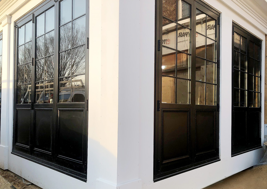 Eight sets of bifold doors with grids and base panels