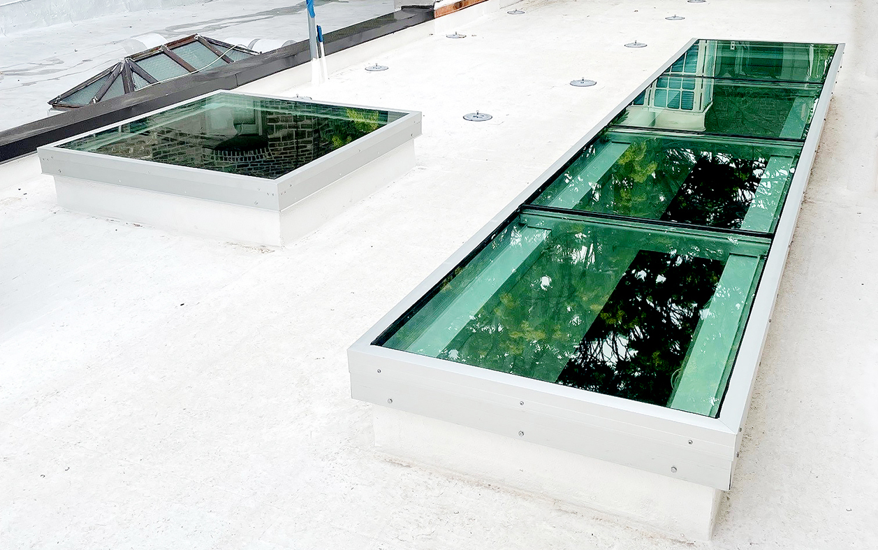 One single-bay and one four-bay single slope welded curb skylight