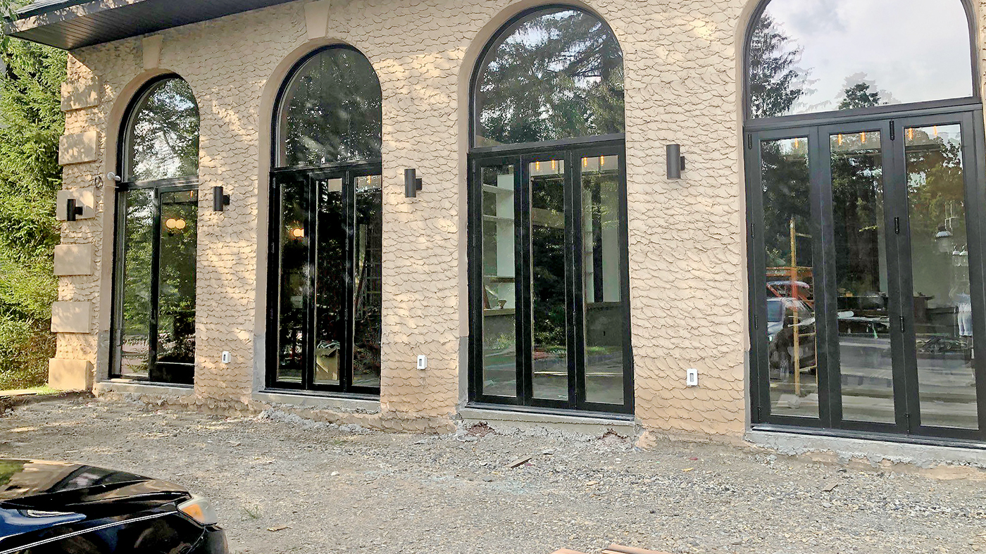 One French Door with a transom finished in Decoral Textured Knotty Pine on both the interior and exterior, one Terrace Door with a sidelite, four Bifold Doors and two Bifold Window units finshed with Decoral Textured Knotty Pine on the interior surfaces only.