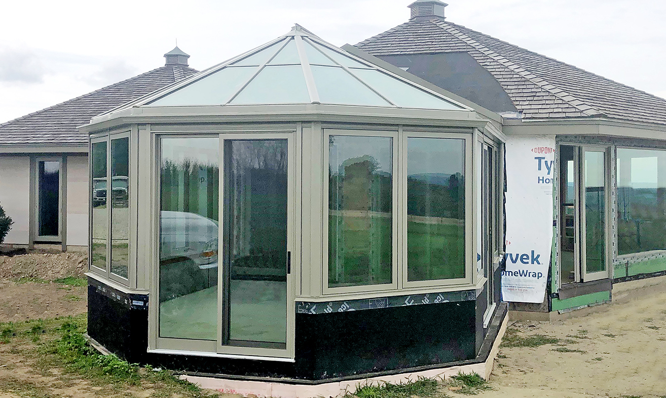 Straight eave double pitch bullnose end sunroom with integrated sliding glass doors and sliding screens