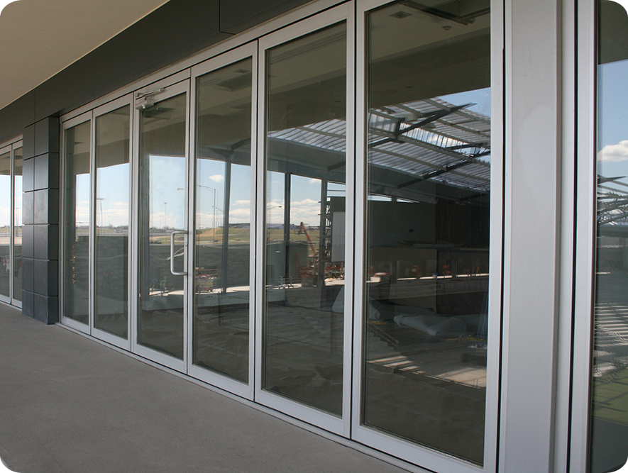 Commercial folding glass walls solar innovationssolar for Retractable walls commercial