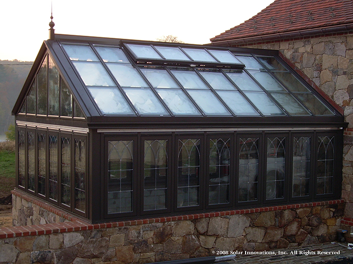 custom residential greenhouse with integrated ridge vent by Solar Innovations, Inc.