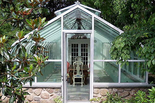 Conservatory curved eave, double pitch structural configuration
